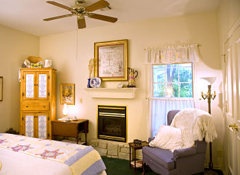 homesteaders bedroom with armour and fireplace