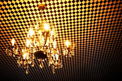 chandelier hanging on checkered ceiling