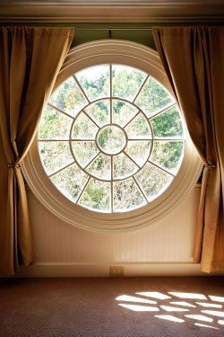 round window with curtains