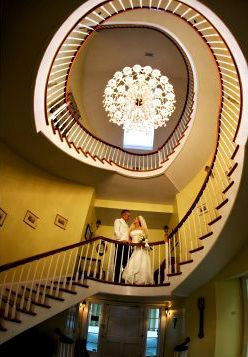 couple standing on spiral stairs in Christopher Place Resort