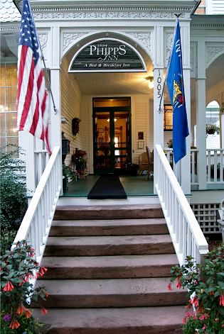 Stairway with flags and phipps inn sign