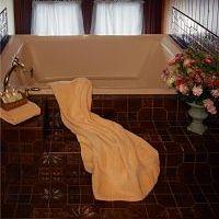 bathrobe on tile bath
