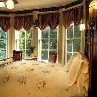 victorian bed with windows