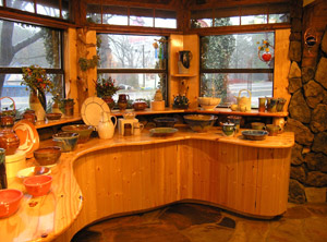 curved wooden counter with dishes
