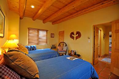 Cowboy or Cowgirl Suite has twin beds and views of Taos Mountain