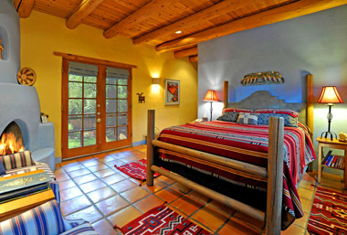 Escondida Room with silverado coverlet, native american rugs, and handmade bed