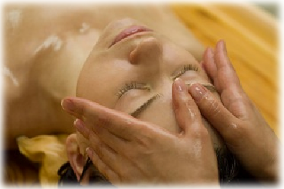 woman girl at spa getting a head massage or facial