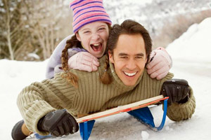 dad sledding with his daughter