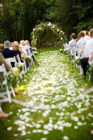 wedding isle covered in white flower petals