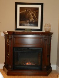 fire place with picture of horses above it at Stone Gate Inn B&B