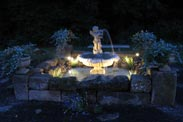 The grounds at night at The Barn Inn