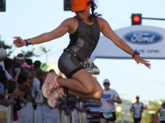 Woman finishing Idaho Ironman triathlon