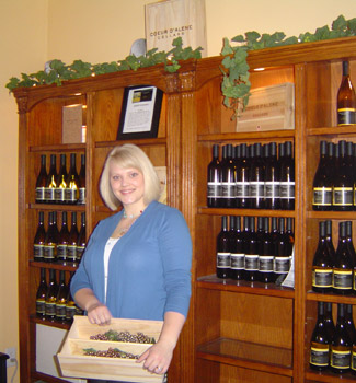 woman in front of wine case