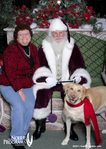 Innkeepers with Santa at Admiral Peary Inn