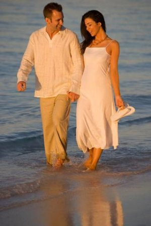 Couple walking along the beach.
