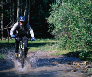 mountain biking in a river
