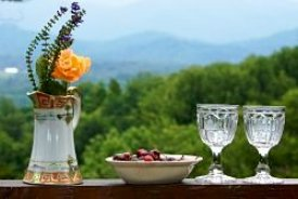 boquet of flowers, cherries in bowl and wine glasses