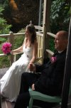 Bride/groom in rocking chairs