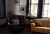 black and yellow sofas and windows