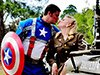 man in captain america costume kissing girl
