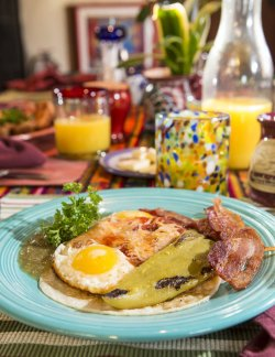 Huevos Rancheros, mexican styled eggs, cheese, salsa, bacon, Tomatia sauce