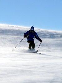skiier skiing on snow