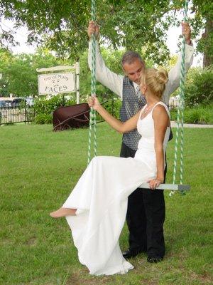 Wedding Couple kissing on Swing