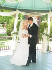 Couple dancing under gazebo