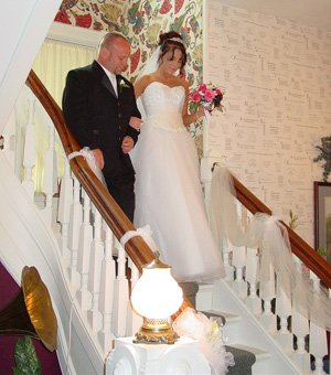 Bride and Father walking down indoor steps