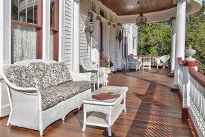 front porch with couches and chairs