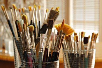 Paintbrushes in jars