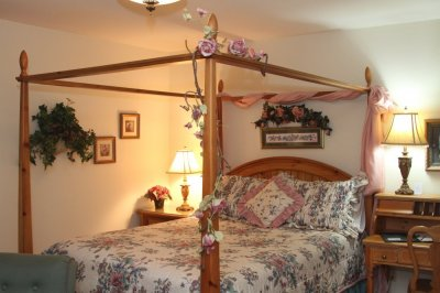 Canopy bed with flowers at Willows Inn