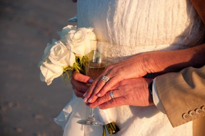 Couple with wedding roses and champagne