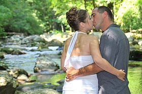 Romantic couple by stream in Smoky Mountain National Park
