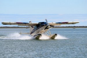 Alaska float plane landing in remote location