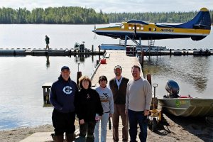 A happy grouo of Crooked Creek guests on their fly out in a float plane