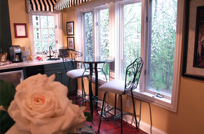 dining room with chairs and flowers