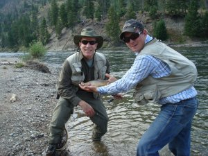 guide and fisherman with fish on yellowstone river