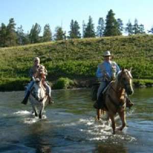 riding horseback across the Lamar river in yellowstone national park