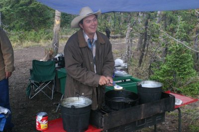 washing dishes in wilderness camp