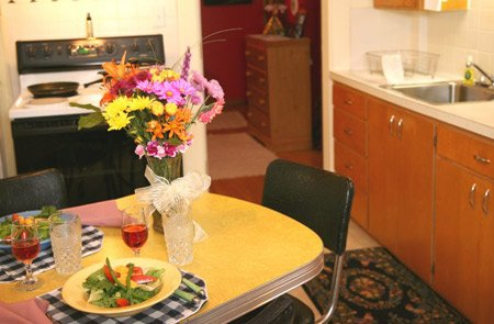 Dining table with floral centerpiece.