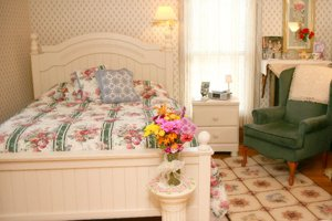 bed and chair with roses
