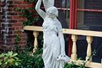 Statue holding vase