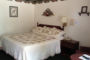 white Bedroom at Crest Country Inn in Williamsburg, Iowa