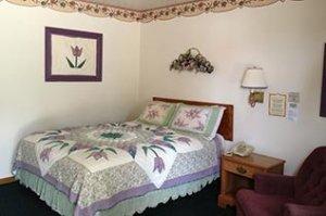 purple Bedroom at Crest Country Inn in Williamsburg, Iowa
