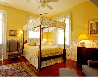 Bedroom at Ashley Inn in Charleston, South Carolina