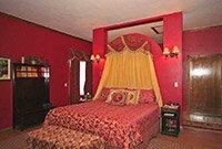 Secret Rose Suite Emerald Dreams at Whispering Pines Bed & Breakfast in Norman OK