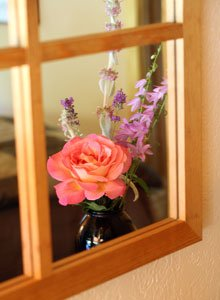 Reflection of Rose in a Wood Frameed Mirror