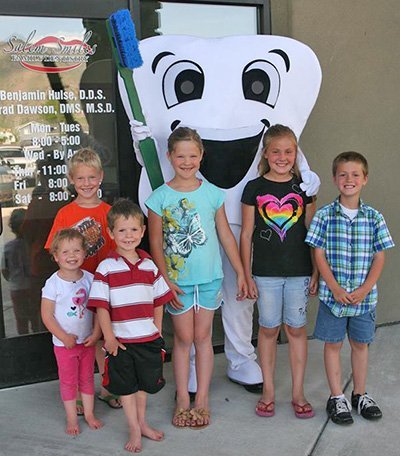 Happy Kids in Front of Salem Smiles Dentist Office in Salem, Utah