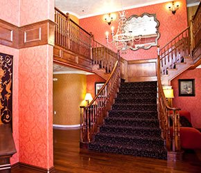 grand staircase at Victorian Inn in Kanab, UT